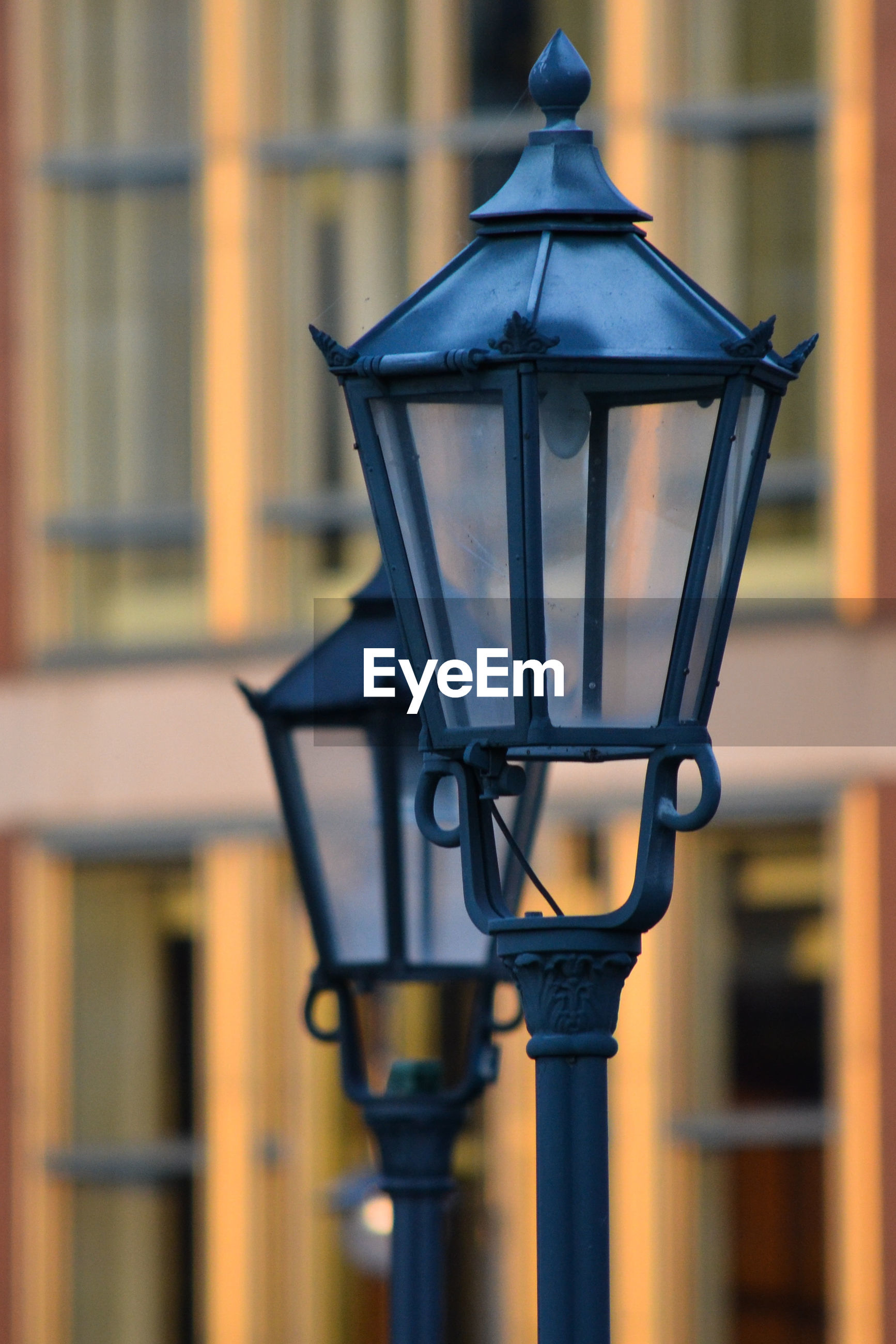 CLOSE-UP OF STREET LIGHT BY BUILDING