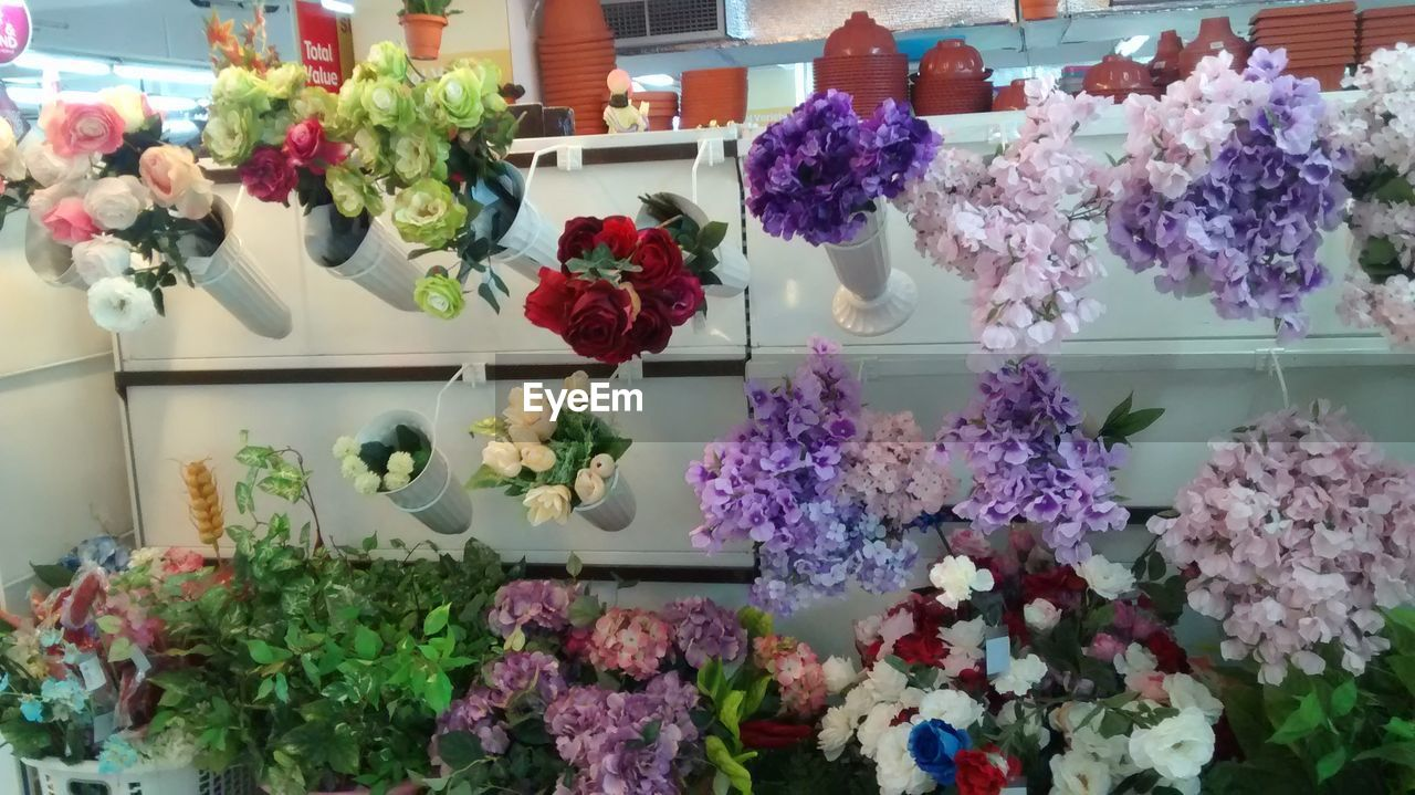 flower, retail, flower shop, variation, retail display, choice, for sale, arrangement, no people, freshness, bouquet, indoors, small business, shelf, store, fragility, beauty in nature, collection, flower market, multi colored, plant, consumerism, nature, day, gift, flower head, florist