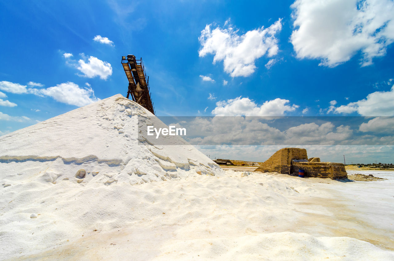 Heap of salt against blue sky