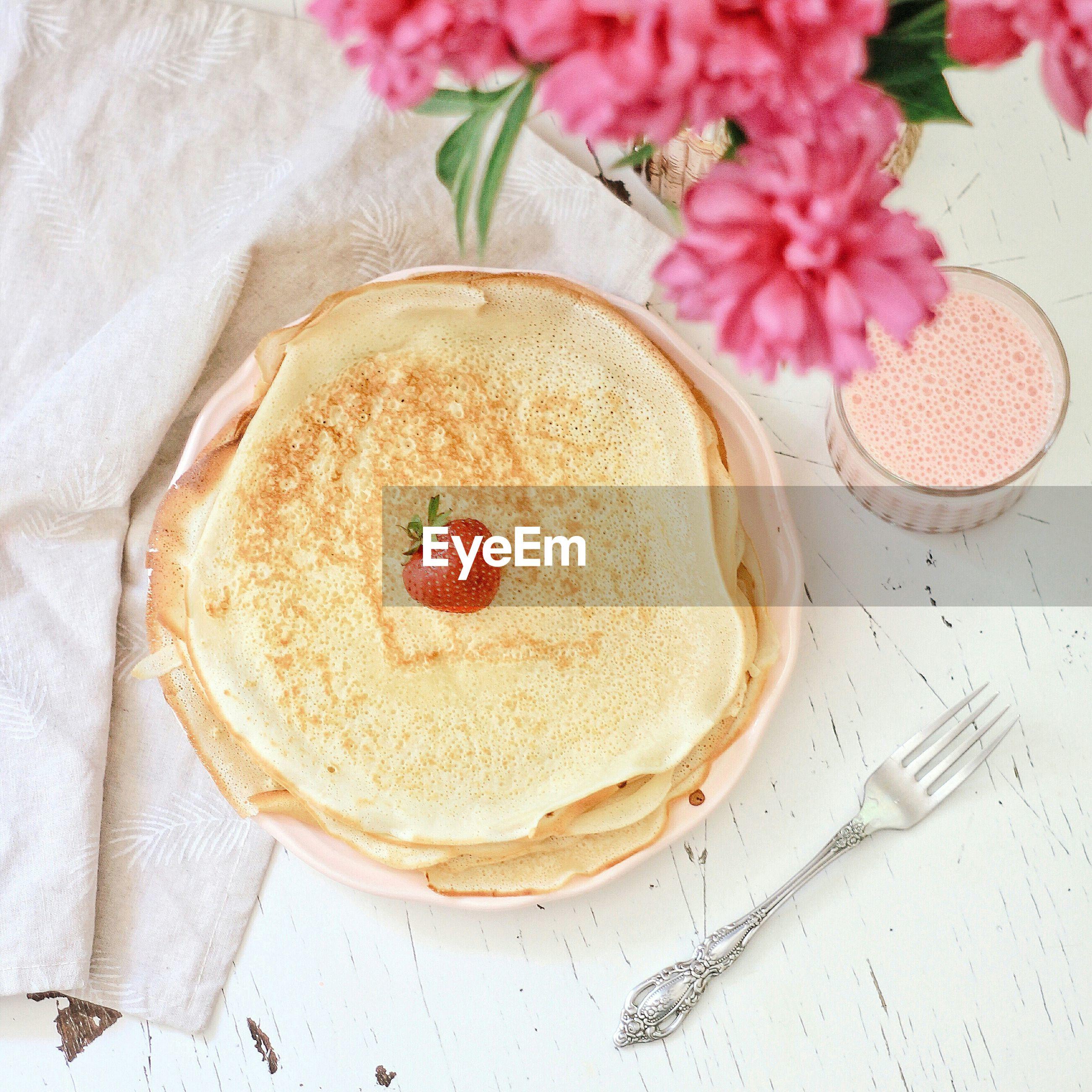 High angle view shot of pancake served on table