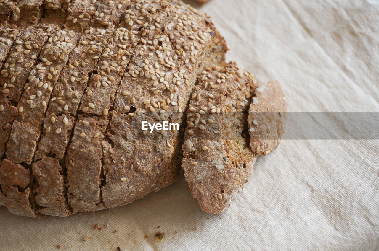 HIGH ANGLE VIEW OF CHOCOLATE BREAD ON TABLE