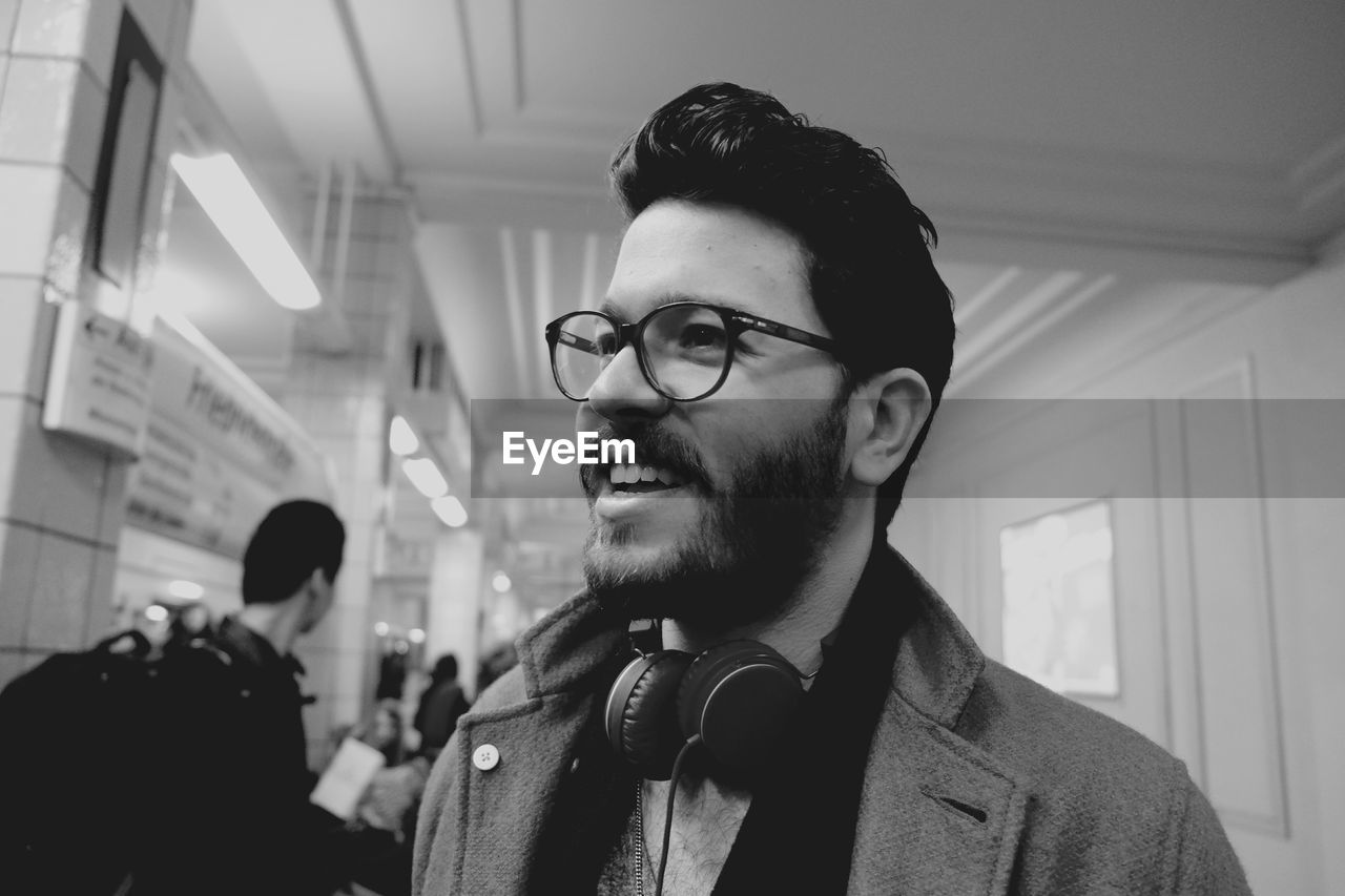 eyeglasses, one person, real people, young adult, focus on foreground, young men, headshot, indoors, glasses, lifestyles, men, standing, happiness, smiling, day, warm clothing, one man only, close-up, people