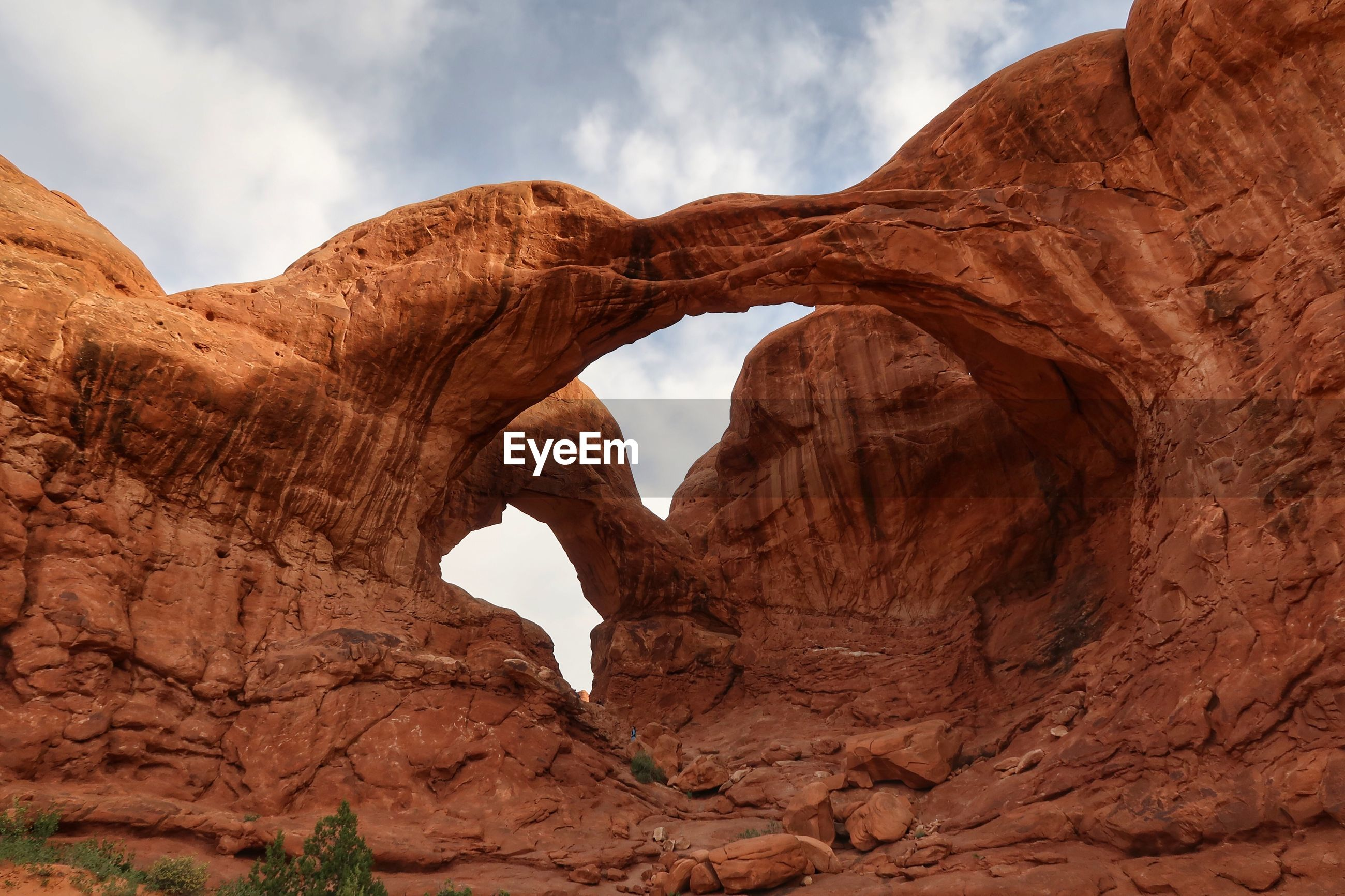 Low angle view of double arch in utah