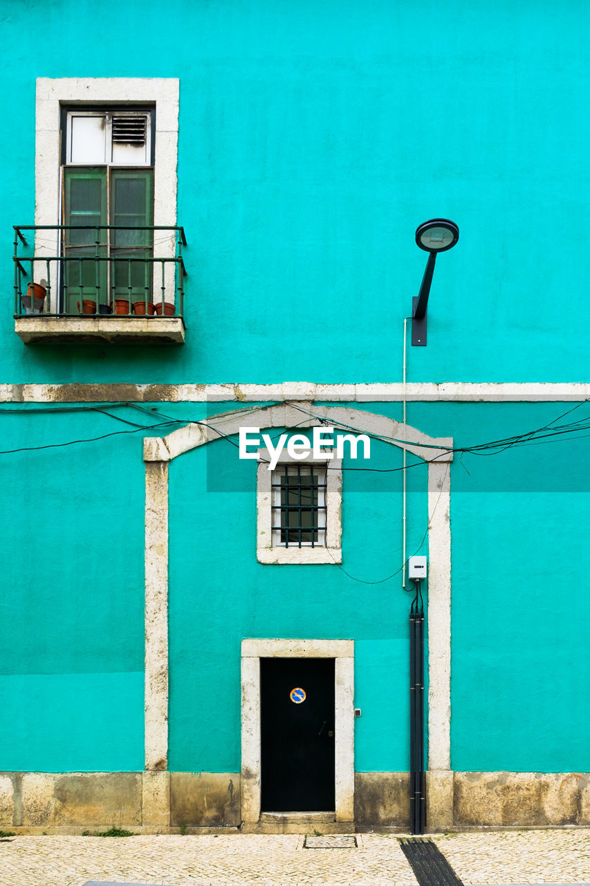 built structure, architecture, building exterior, door, entrance, window, no people, building, day, blue, green color, wall - building feature, residential district, closed, turquoise colored, outdoors, house, nature, safety, security
