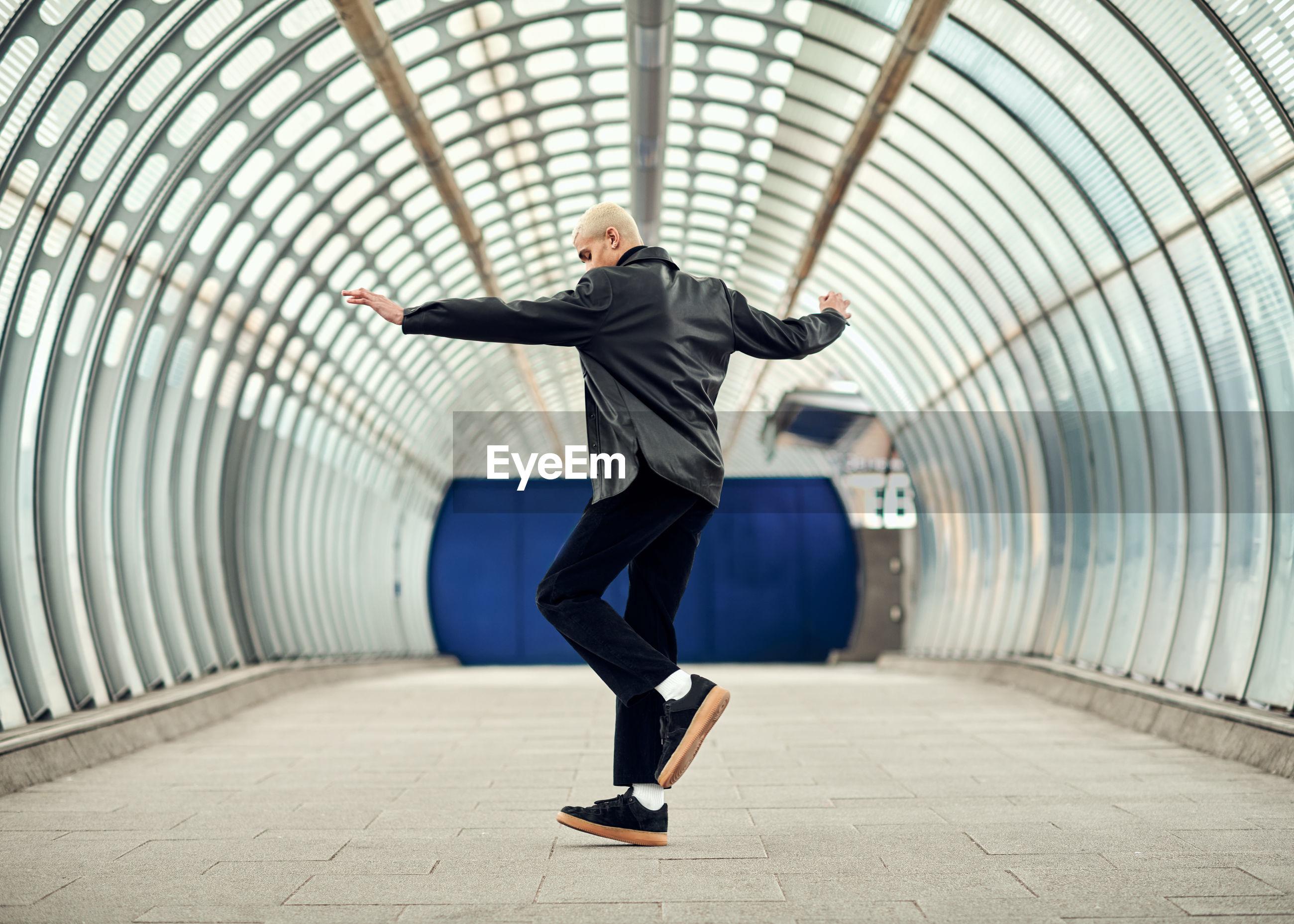 FULL LENGTH OF MAN ON FOOTPATH