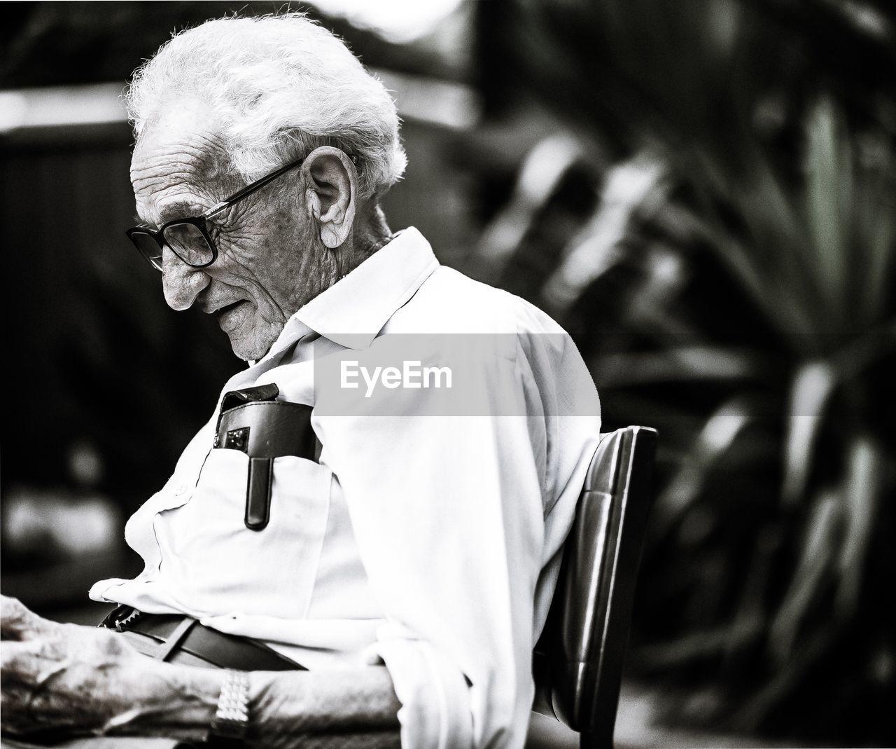 Close-up of senior man in garden