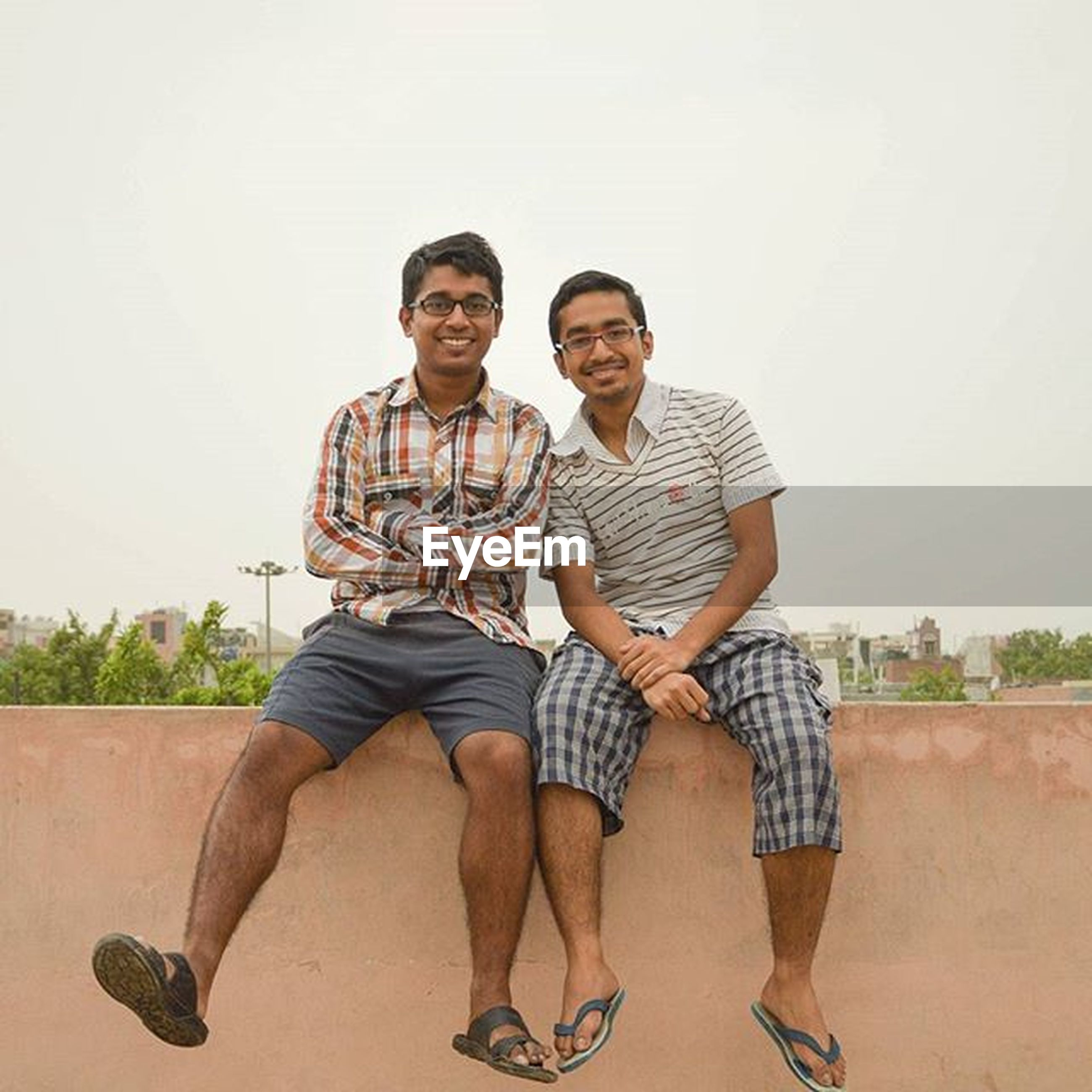 lifestyles, casual clothing, togetherness, leisure activity, full length, young adult, bonding, standing, person, front view, young men, friendship, sitting, love, happiness, looking at camera