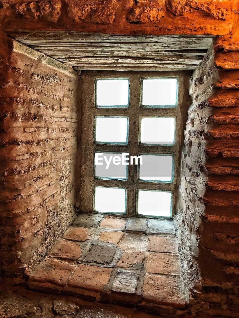 window, built structure, architecture, wall, no people, old, day, wall - building feature, building, brick, brick wall, indoors, pattern, house, weathered, glass - material, low angle view, abandoned, window frame, deterioration