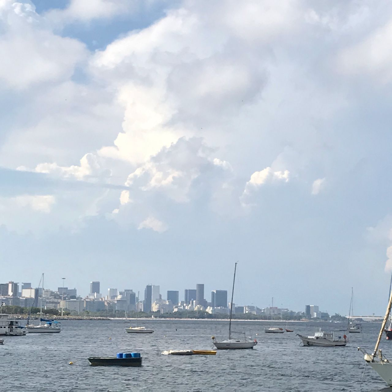 water, sky, cloud - sky, nautical vessel, architecture, building exterior, built structure, city, waterfront, transportation, sea, day, building, mode of transportation, nature, cityscape, no people, urban skyline, outdoors, skyscraper, office building exterior, sailboat, yacht