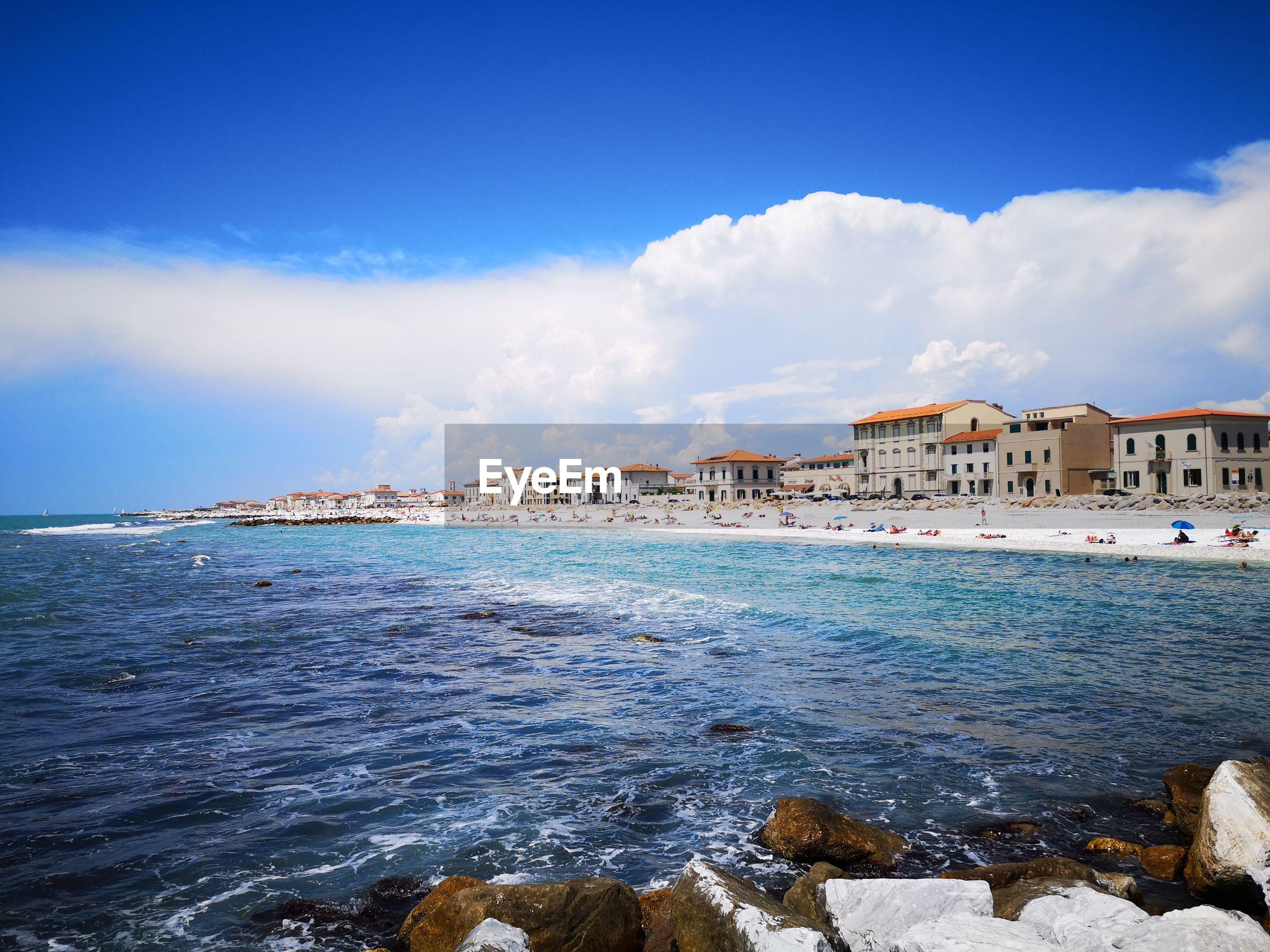 SEA AND BUILDINGS AGAINST SKY