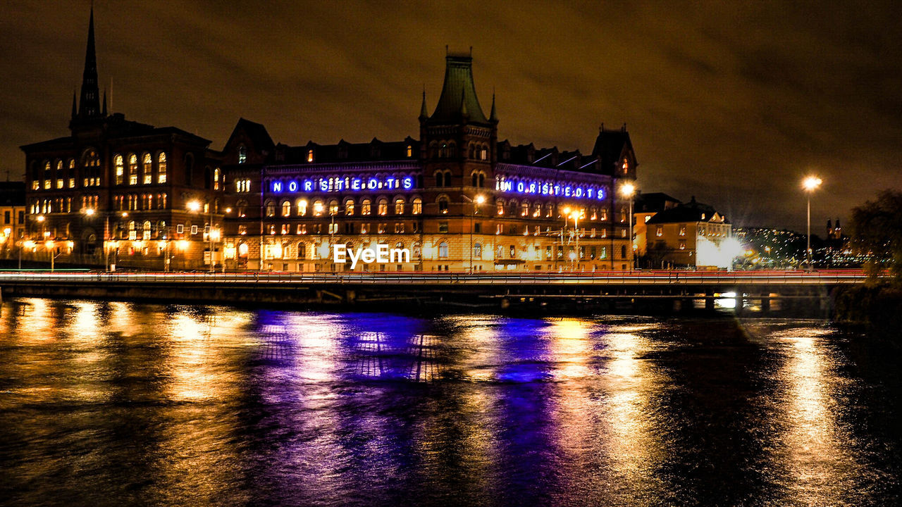 illuminated, night, building exterior, architecture, built structure, reflection, water, waterfront, city, building, river, no people, sky, travel destinations, nature, glowing, outdoors, the past, dusk, light