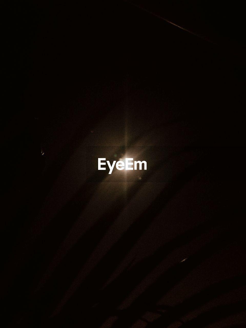 illuminated, dark, no people, night, spotlight, moon, low angle view, indoors, astronomy
