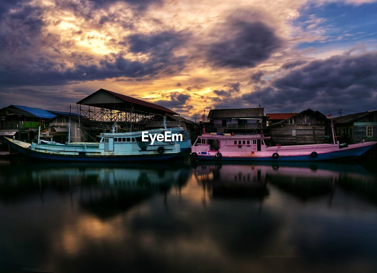 cloud - sky, water, sky, sunset, nautical vessel, reflection, transportation, mode of transportation, built structure, architecture, moored, waterfront, nature, no people, building exterior, beauty in nature, tranquility, orange color, scenics - nature, outdoors, fishing boat