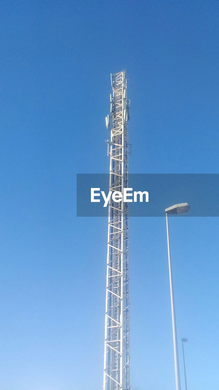low angle view, blue, copy space, day, development, clear sky, no people, progress, outdoors, architecture, vapor trail, sky