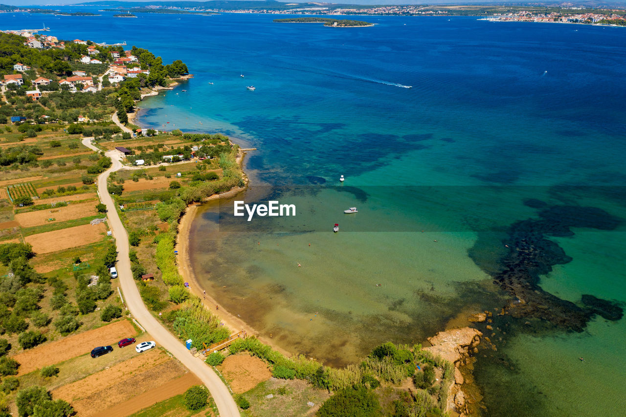 HIGH ANGLE VIEW OF BAY AND SEA
