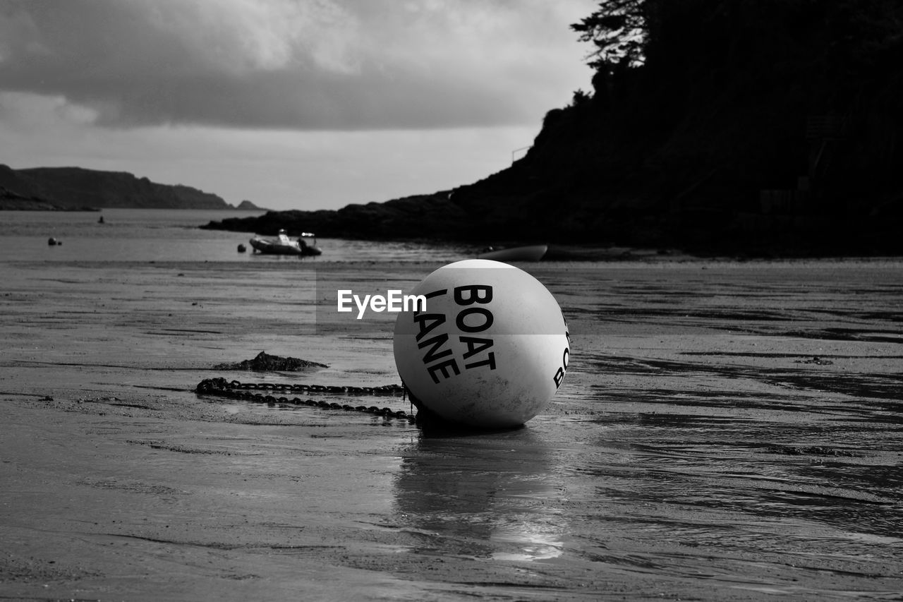 sky, water, no people, nature, day, cloud - sky, text, number, land, focus on foreground, close-up, sea, mountain, beach, ball, scenics - nature, outdoors, tranquil scene, non-urban scene