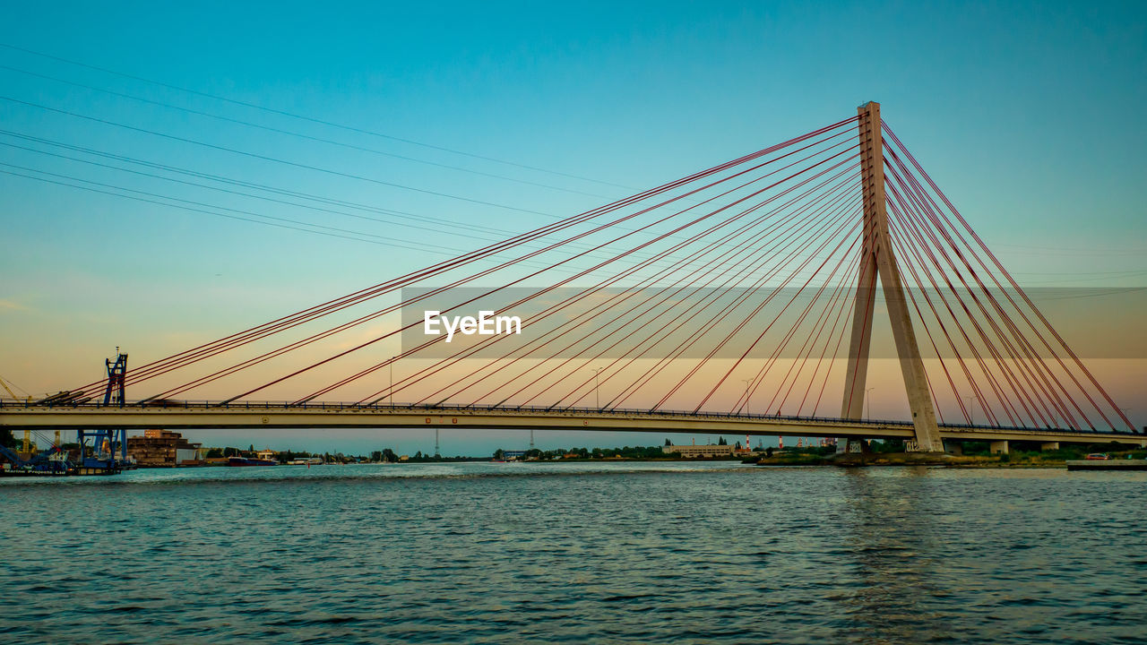 bridge, bridge - man made structure, connection, built structure, sky, architecture, water, engineering, transportation, suspension bridge, cable, nature, river, waterfront, cable-stayed bridge, clear sky, travel destinations, building exterior, outdoors, bay