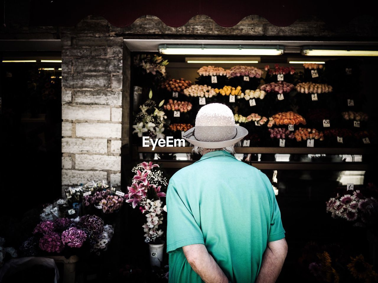 Rear View Of Senior Man Against Flower Store