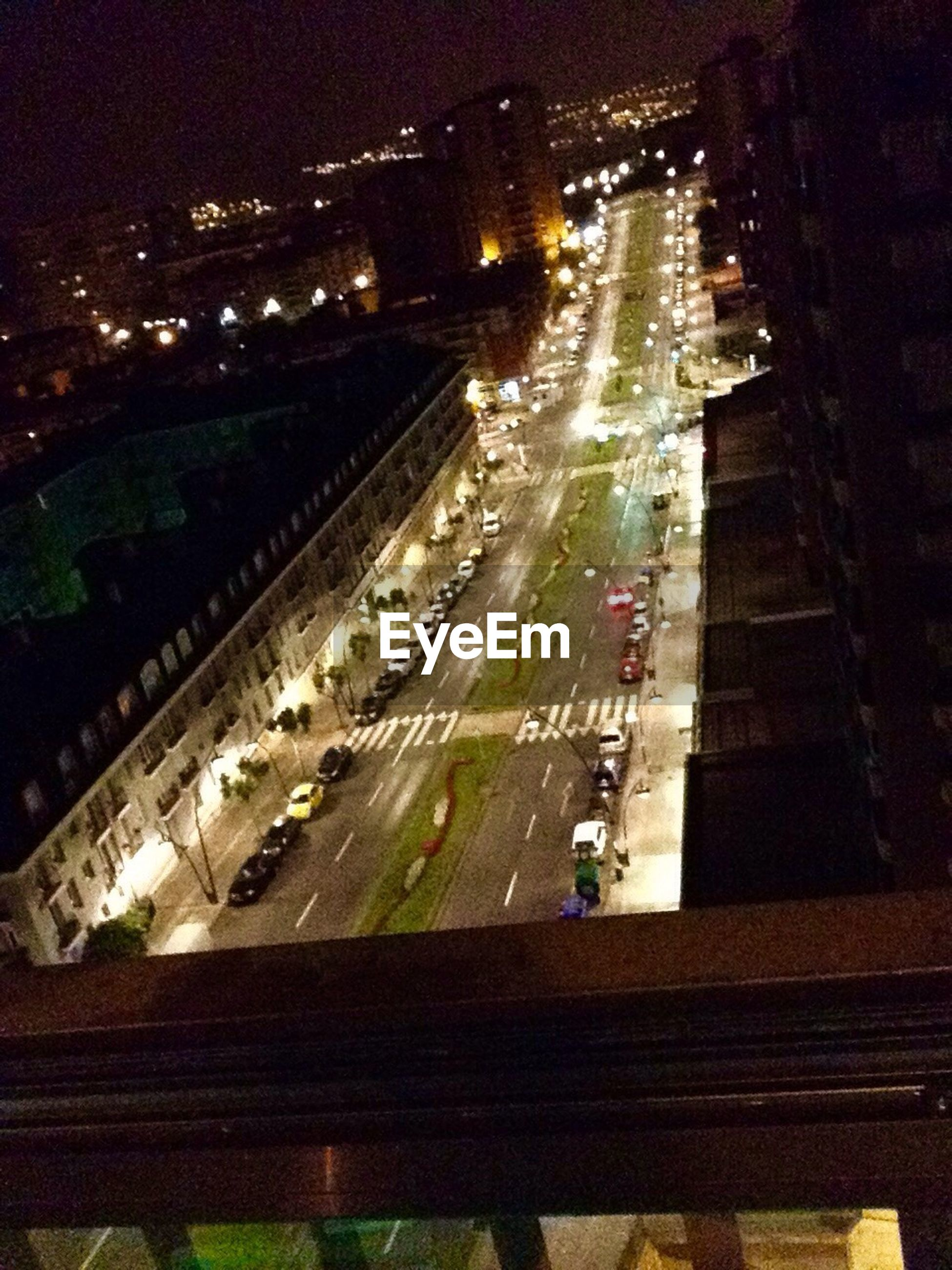 transportation, high angle view, building exterior, built structure, architecture, city, railroad track, night, mode of transport, illuminated, road, car, street, city life, land vehicle, the way forward, city street, incidental people, public transportation, rail transportation