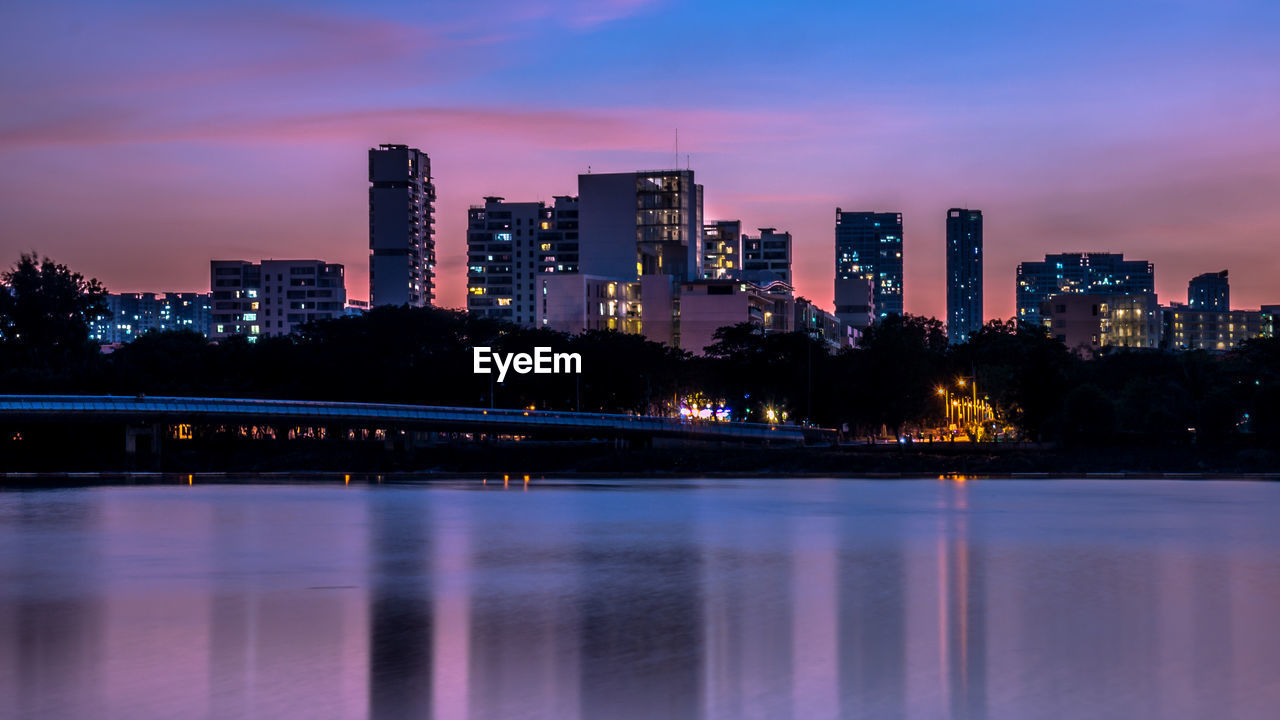 building exterior, built structure, architecture, illuminated, water, sky, city, waterfront, reflection, building, nature, dusk, cityscape, no people, river, urban skyline, sunset, cloud - sky, landscape, office building exterior, outdoors, skyscraper, modern, financial district