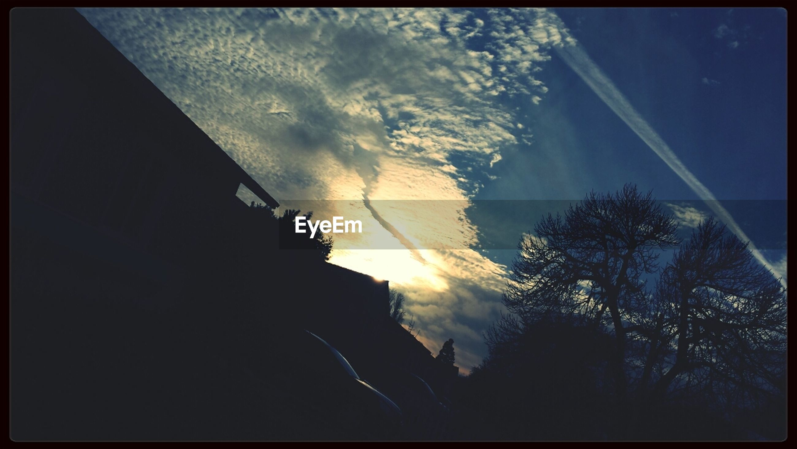 transfer print, low angle view, sky, silhouette, auto post production filter, beauty in nature, scenics, nature, cloud - sky, tree, tranquility, tranquil scene, outdoors, vapor trail, no people, dusk, night, cloud, blue, sunset
