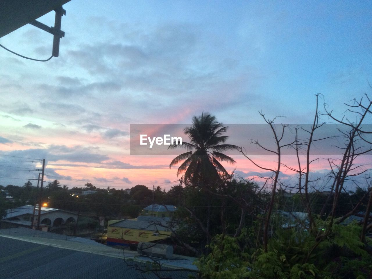 sky, sunset, car, transportation, mode of transport, cloud - sky, no people, nature, land vehicle, beauty in nature, outdoors, built structure, tree, scenics, palm tree, building exterior, day