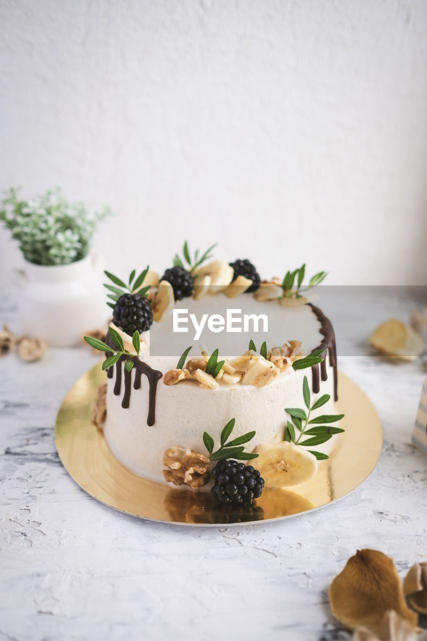 food and drink, freshness, food, indoors, still life, table, indulgence, no people, ready-to-eat, herb, plant, close-up, plate, leaf, plant part, serving size, white color, garnish, sweet food, healthy eating, temptation, mint leaf - culinary