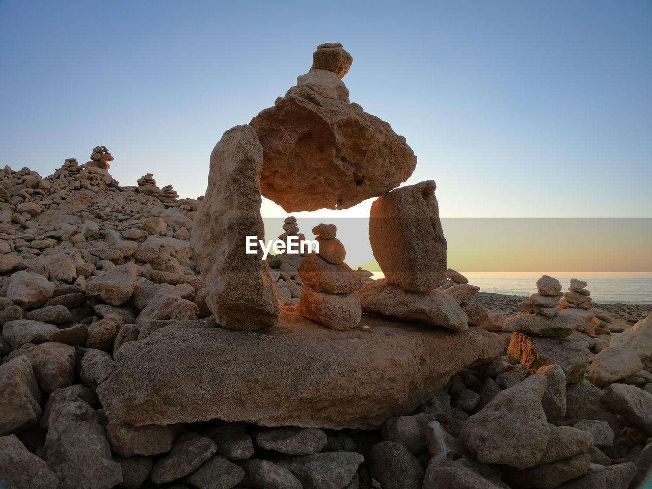 rock, solid, rock - object, sky, rock formation, nature, tranquility, clear sky, beauty in nature, no people, sea, balance, land, tranquil scene, day, water, scenics - nature, beach, non-urban scene, outdoors