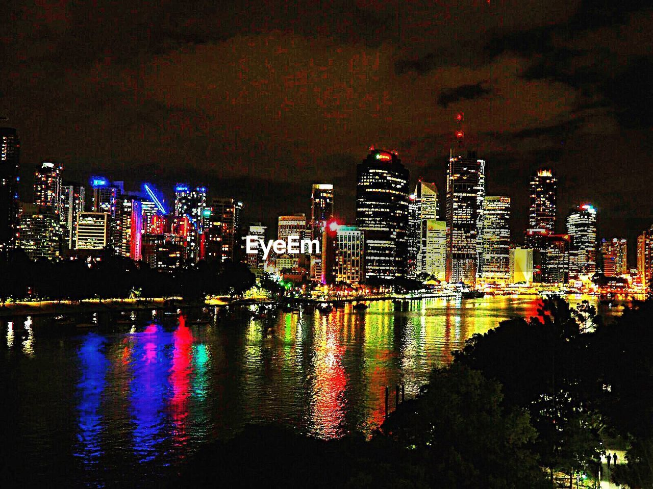 night, illuminated, architecture, building exterior, skyscraper, built structure, city, modern, cityscape, reflection, travel destinations, urban skyline, multi colored, city life, outdoors, sky, no people, growth, waterfront, downtown district