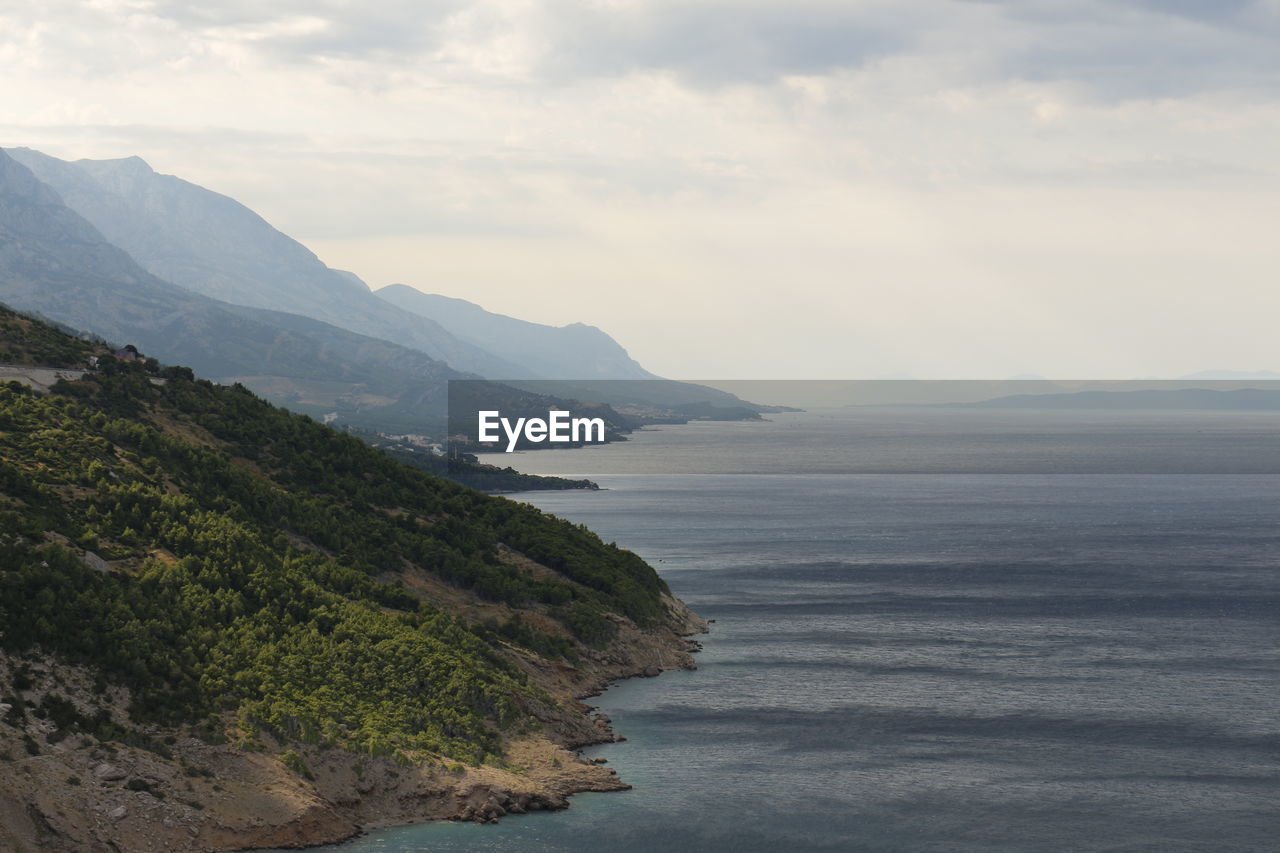 High Angle View Of Coastal Feature By Calm Sea