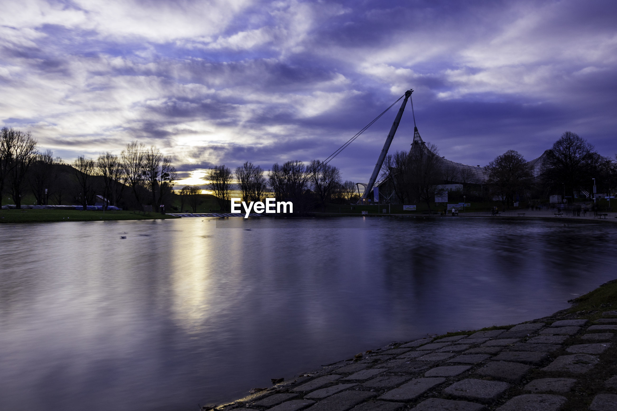 Scenic view of river against sky at dusk