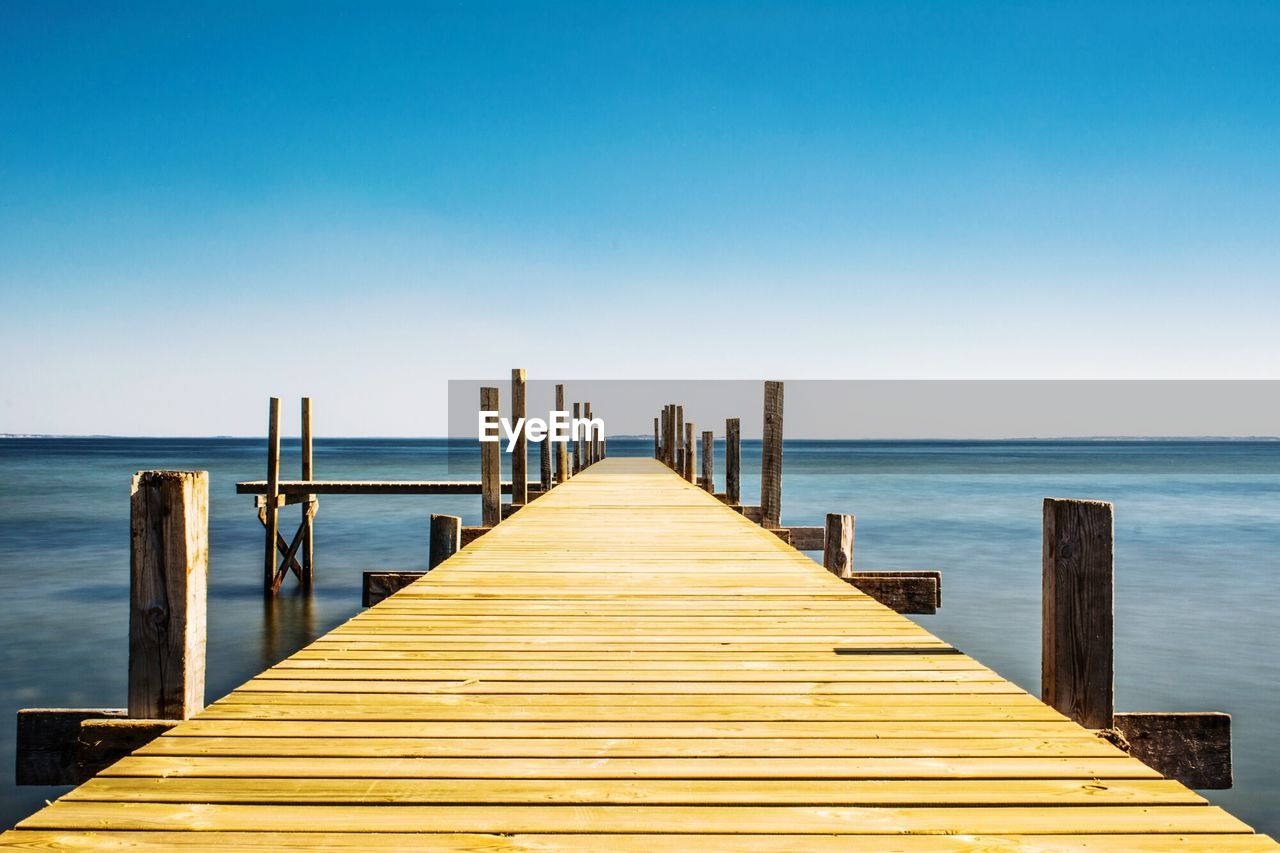 Jetty In Sea Against Clear Sky