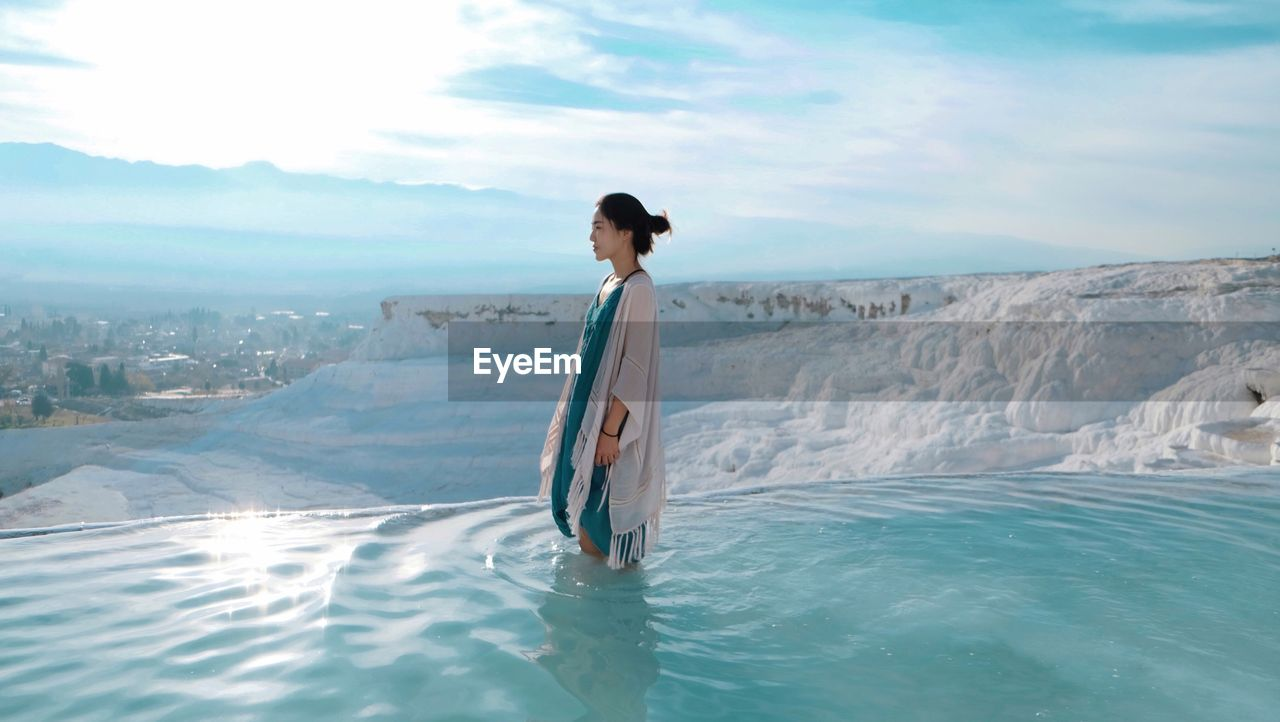 Young Woman Standing At Travertine Pools In Pamukkale
