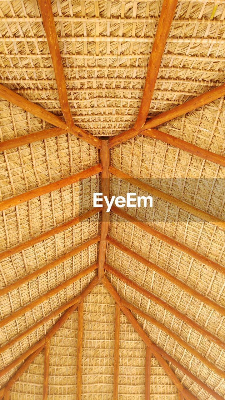 low angle view, indoors, thatched roof, full frame, no people, backgrounds, close-up, architecture, day