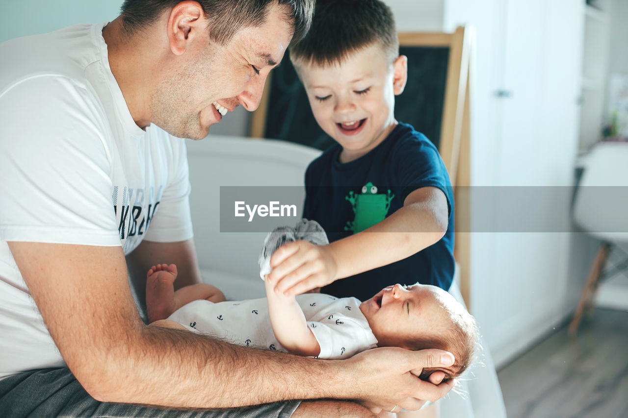 Father playing with children at home