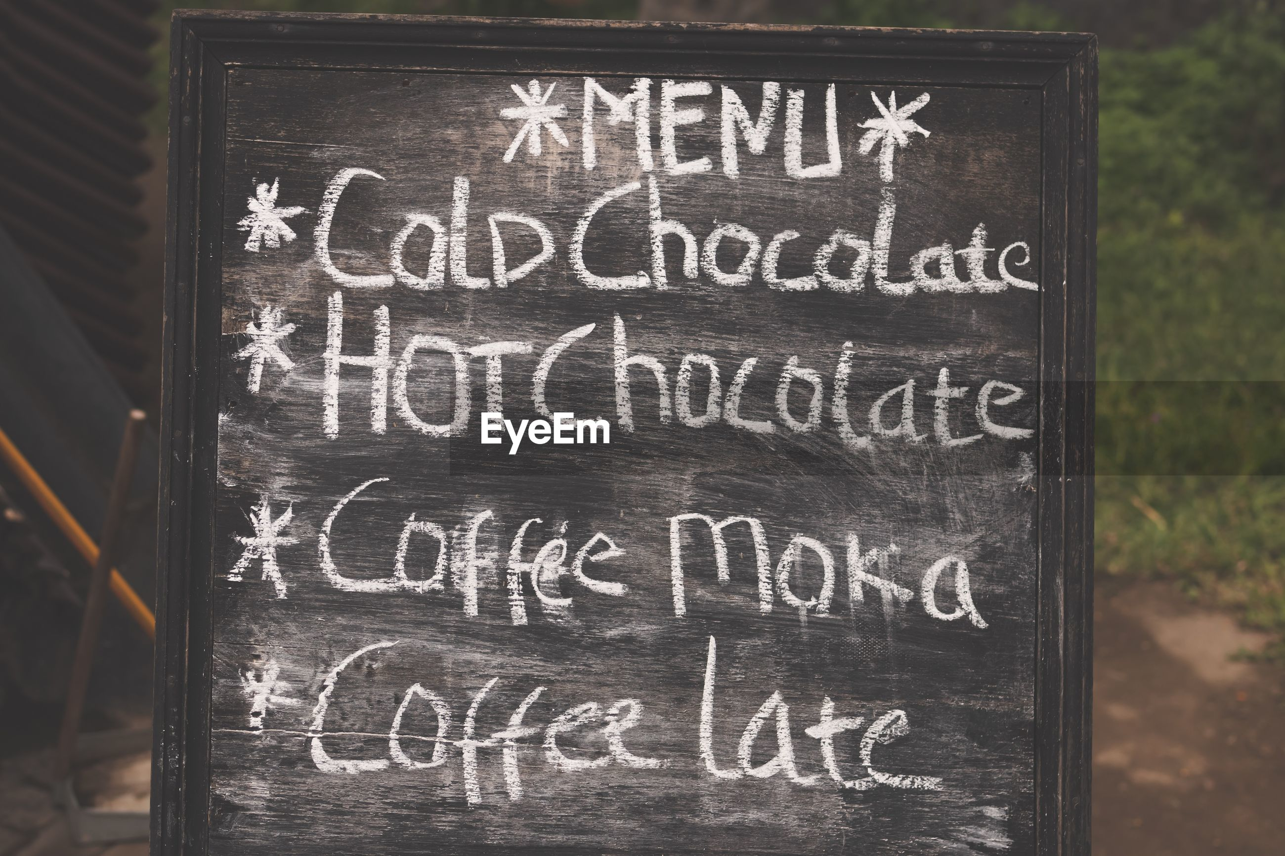 Text on blackboard at cafe