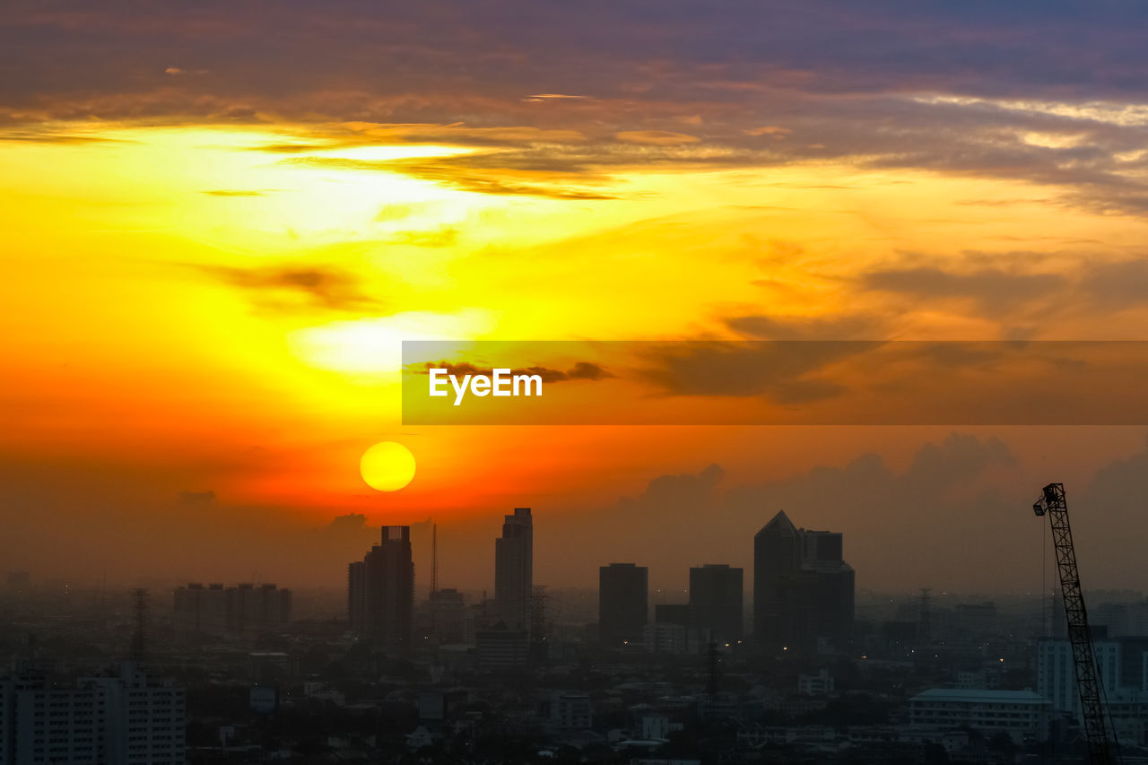 sunset, building exterior, architecture, sky, orange color, built structure, cloud - sky, city, cityscape, building, nature, sun, no people, office building exterior, beauty in nature, skyscraper, tall - high, landscape, tower, residential district, outdoors, modern, romantic sky
