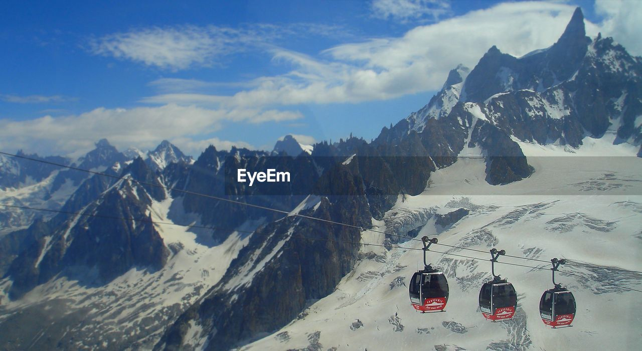 snow, winter, cold temperature, mountain, nature, weather, snowcapped mountain, transportation, mountain range, beauty in nature, scenics, mode of transport, sky, ski lift, hanging, overhead cable car, outdoors, day, frozen, tranquility, cable, cloud - sky, landscape, sunlight, no people, ski holiday
