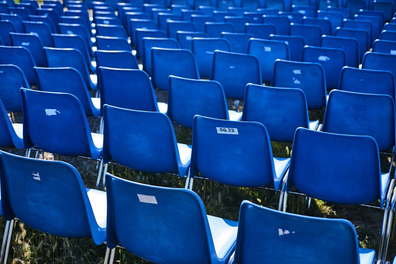Full Frame Shot Of Blue Empty Seats In Stadium