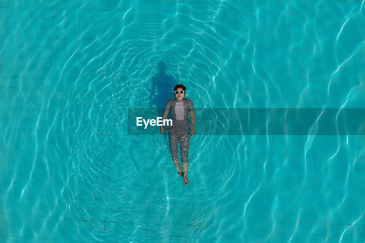 Directly Above Shot Of Woman Swimming In Pool