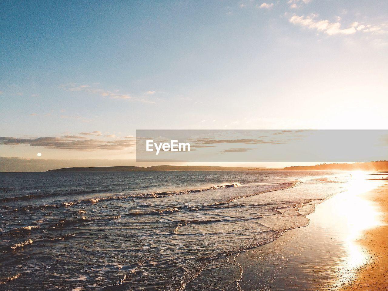 sky, water, beauty in nature, sea, scenics - nature, beach, land, tranquility, tranquil scene, cloud - sky, sunset, nature, idyllic, wave, non-urban scene, sunlight, no people, outdoors, horizon, bright