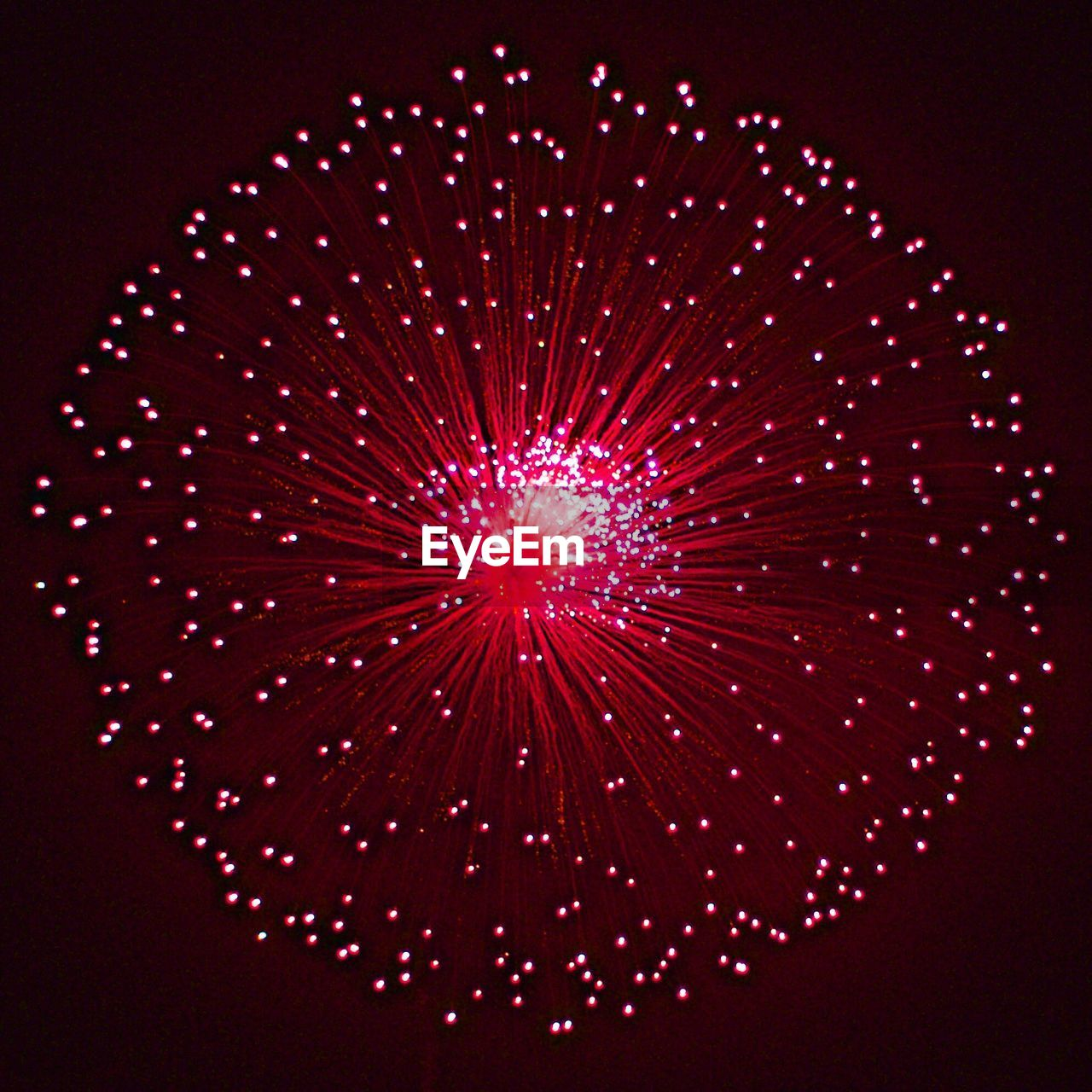 night, exploding, firework display, celebration, firework - man made object, illuminated, low angle view, arts culture and entertainment, no people, long exposure, red, multi colored, sky, indoors