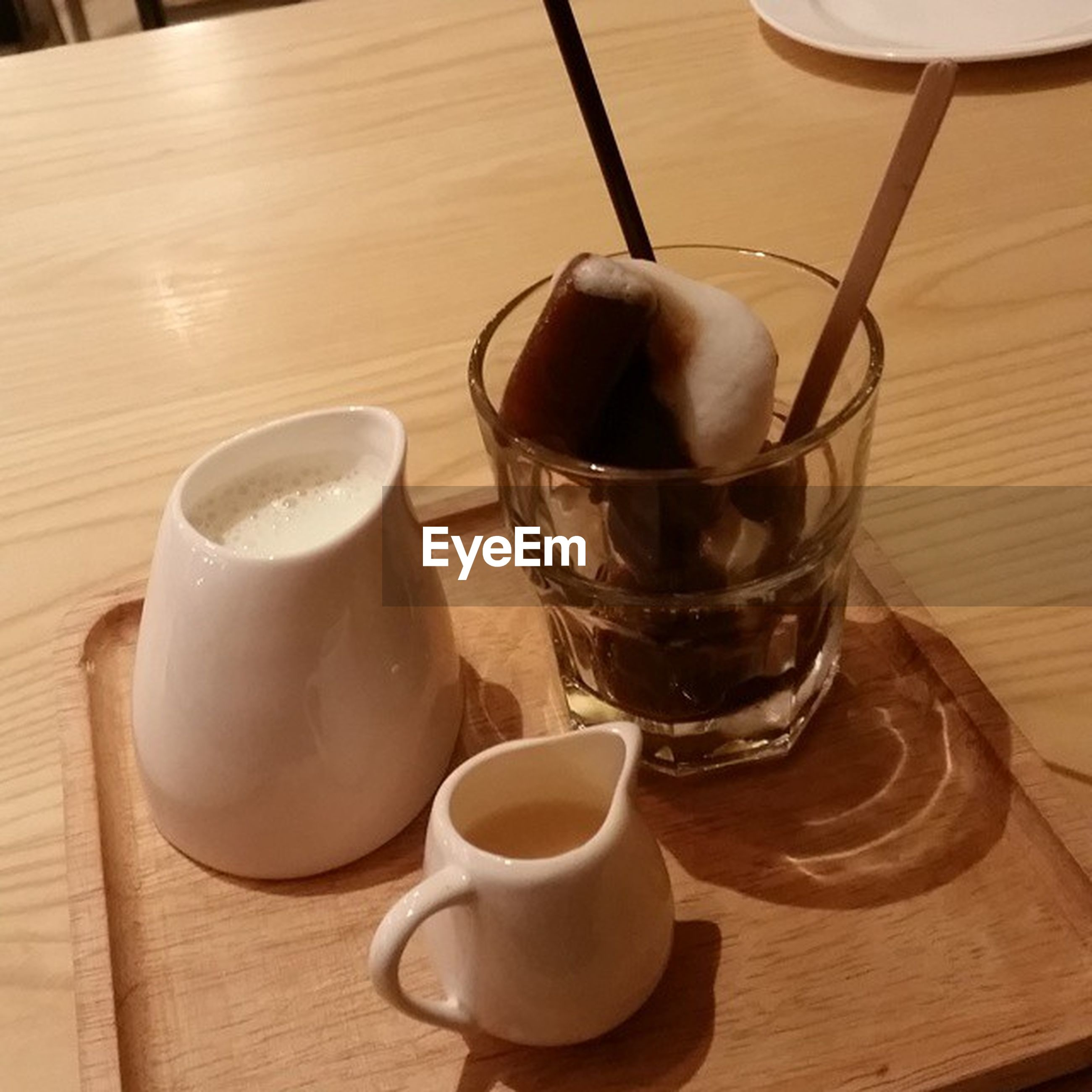 table, food and drink, indoors, drink, refreshment, coffee cup, still life, coffee - drink, freshness, wood - material, spoon, saucer, wooden, high angle view, coffee, close-up, cup, no people, healthy eating, frothy drink