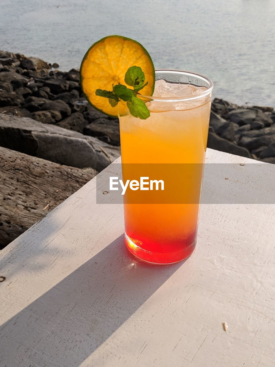 refreshment, glass, drink, drinking glass, food and drink, household equipment, freshness, fruit, alcohol, orange color, healthy eating, food, table, no people, cocktail, close-up, still life, wood - material, citrus fruit, nature, mint leaf - culinary, herb, orange, tropical drink, garnish