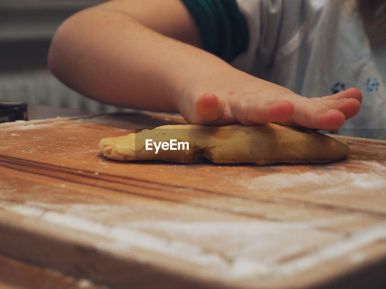 food and drink, food, freshness, preparation, dough, indoors, one person, selective focus, preparing food, real people, human hand, domestic room, midsection, hand, kitchen, wood - material, homemade, cutting board, table, close-up, chef, kneading, baked pastry item
