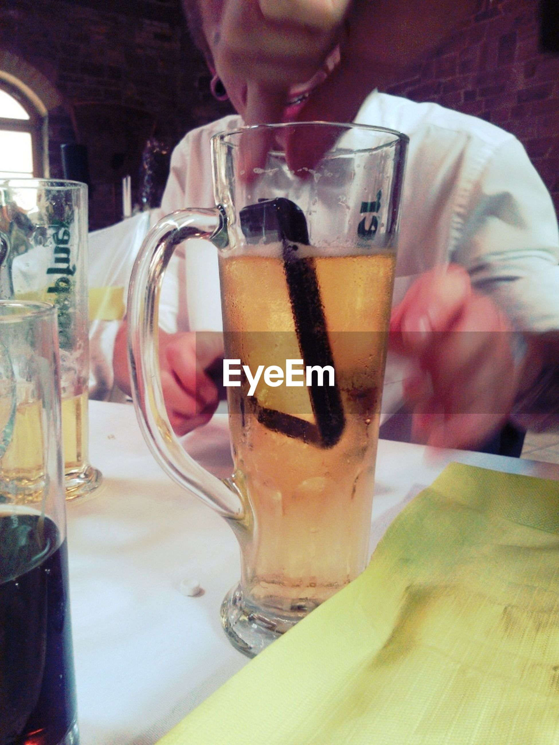 food and drink, drink, freshness, refreshment, drinking glass, indoors, table, food, alcohol, close-up, restaurant, indulgence, sweet food, glass - material, unhealthy eating, focus on foreground, drinking straw, still life