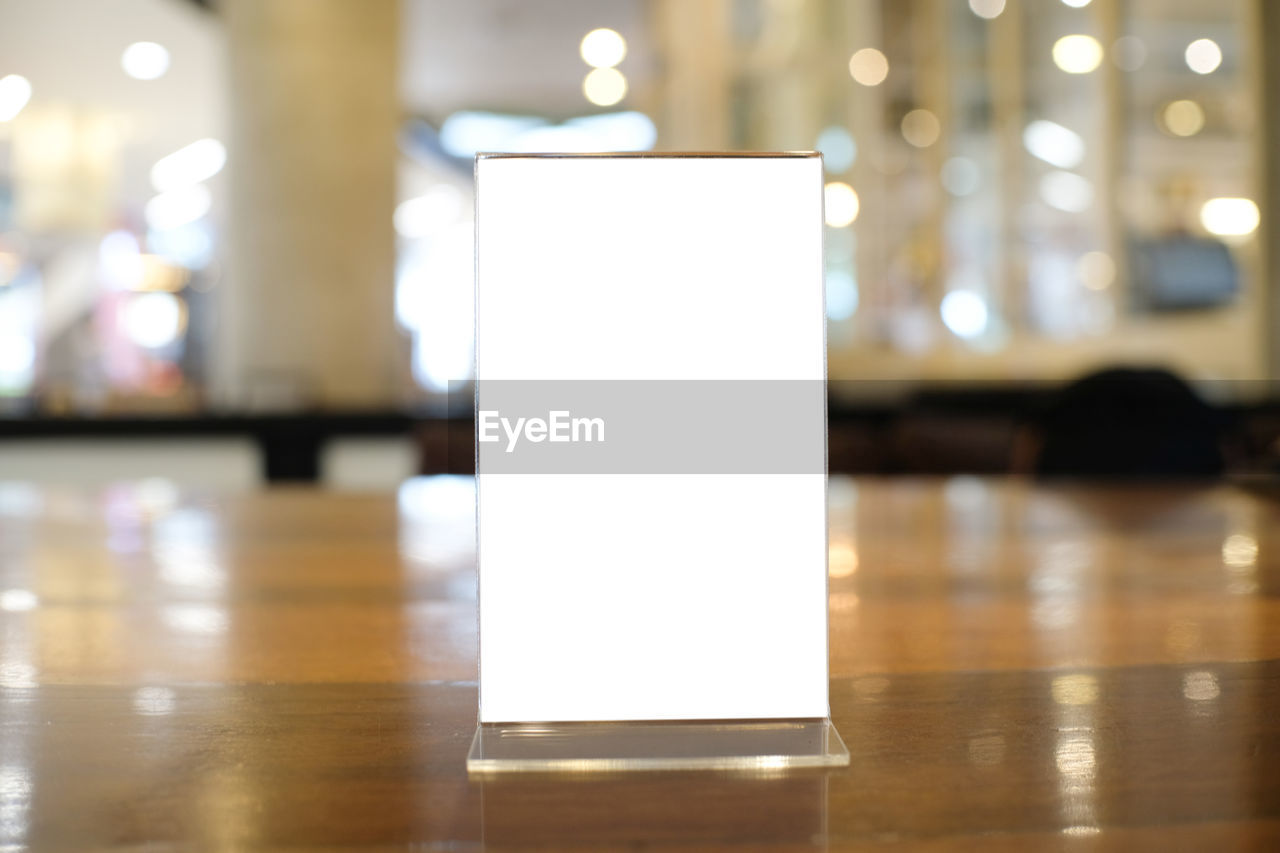 Close-up of placard on table