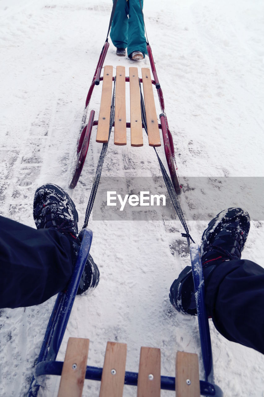 Low section of man with snow on shoes