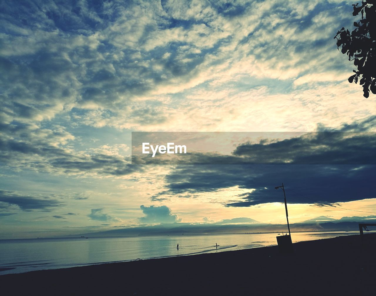 sky, cloud - sky, sea, beauty in nature, nature, water, silhouette, scenics, tranquil scene, sunset, tranquility, horizon over water, outdoors, no people, day, beach, tree