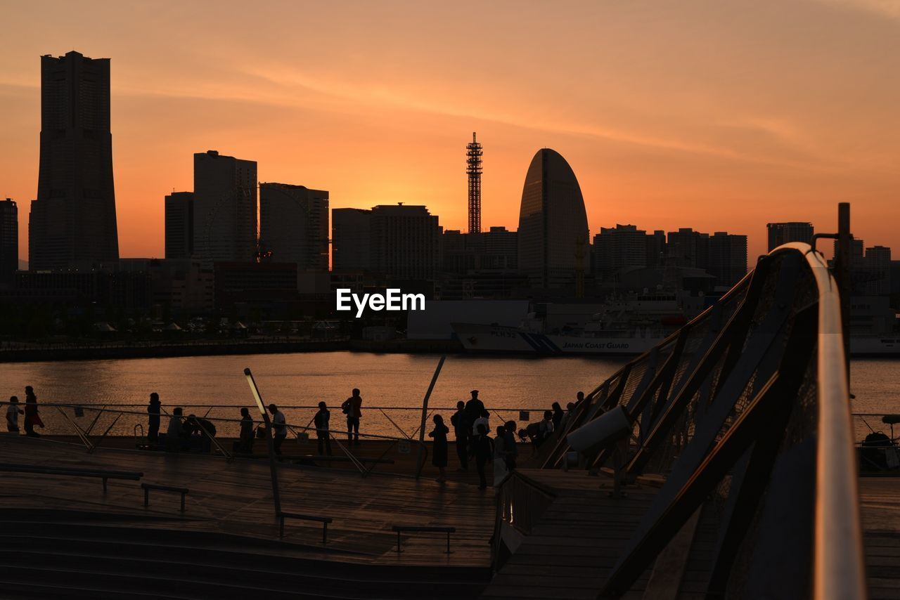 People At Osanbashi Pier Against Sky During Sunset